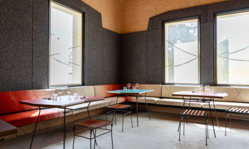 Banquette seating filled with rice straw, upholstered in Arles Merino wool and dyed with madder (garance de Provence), wrought-iron tables and stools with bioplastics made with grignon d'olive additives, wall coating made with rice straw and ochres, biolaminate panels made with mussel shells, and window screens made paper yarn dyed with the reseda plant., © Adrian Deweerdt